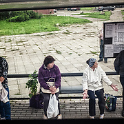 People at a bus stop in Narva
