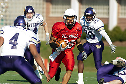 29 October 2005: Redbird Jason Horton heads upfield leaving Leathernecks scattered behind him and looking for more yards. With a final score of 31 - 17, Western Illinois University Leathernecks collared the Illinois State University Redbirds knocking them from their 18th ranked perch at Hancock Field on Illinois State's campus in Normal IL