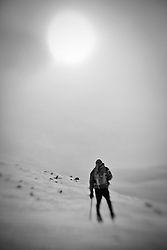 A hiker braves winter conditions near the summit of Mount Washington in New Hampshire's White Mountains.