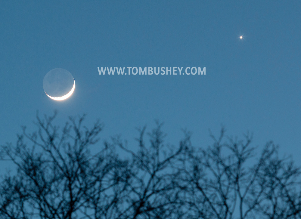 Middletown, New York - The crescent moon and the planet Venus shine in the twilight sky on March 22, 2015.