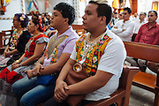"Angelo Martinez Linares, 24, during a mass in Juchitán, Mexico.<br /> <br /> In Juchitán in the southern state of Oaxaca, Mexico, the world is not divided simply into gay and straight, the locals make room for a third category, whom they call ""muxes"".<br /> <br /> Muxes are men who consider themselves women and live in a socially sanctioned netherworld between the two genders. ""Muxe"" is a Zapotec word derived from the Spanish ""mujer"" or woman; it is reserved for males who, from boyhood, have felt themselves drawn to living as a woman, anticipating roles set out for them by the community.<br /> <br /> They are considered hard workers that will forever stay by their mothers side, taking care for their families operating as mothers without children of their own.<br /> <br /> Not all muxes express they identities the same way. Some dress as women and take hormones to change their bodies. Others favor male clothes. What they share is that the community accepts them."