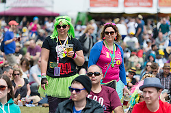 © Licensed to London News Pictures. 13/06/2015. Isle of Wight, UK.  Festival goers watch Nothing but Thieves perform at Isle of Wight Festival 2015 on Saturday Day 3.  Yesterday suffered torrential rain all afternoon and evening, after a first day of warm sun.  This years festival include headline artists the Prodigy, Blur and Fleetwood Mac.  Photo credit : Richard Isaac/LNP
