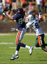 Virginia wide receiver Jared Green (84) makes a reception while being defended by Miami (FL) defensive back DeMarcus Van Dyke (8).  The Miami Hurricanes defeated the Virginia Cavaliers 24-17 in overtime in a NCAA Division 1 Football game at Scott Stadium on the Grounds of the University of Virginia in Charlottesville, VA on November 1, 2008.