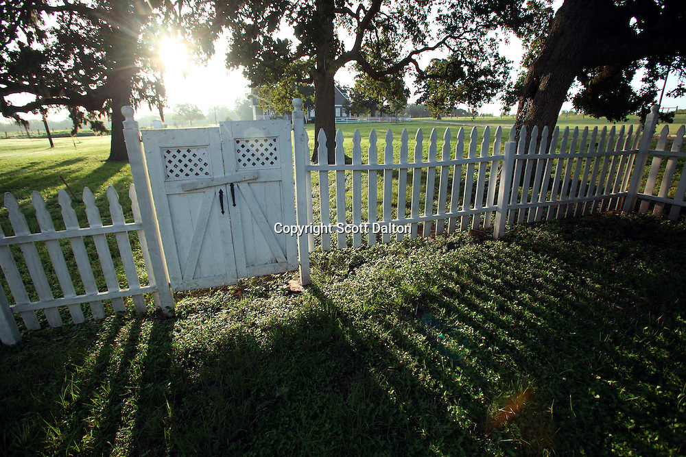 A white picket fence at the Lonesome Pine Ranch of Taunia and John Elick where they keep many of their restored homes in Chappell Hill, Texas on Monday September 14, 2009. The couple rescues old houses and move them to their Texas ranch where after extensive repairs and remodeling they turn them into bed and breakfasts. Their bed and breakfast is called Texas Ranch Life. (Photo/Scott Dalton)