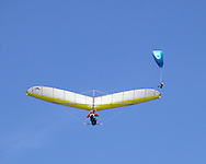 Ellenville, NY - A hang glider and a paraglider soar in the sky on Oct. 25, 2009.