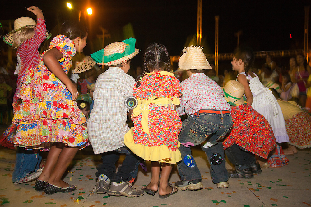 """Festa junina infantil em Parnamirim. Celebracao tradicional brasileira que ocorre no mes de junho, festejando tres importantes santos catolicos: Sao Joao (24 de junho), Sao Pedro (29 de junho) e Santo Antonio (13 de junho) / The Festa Junina (""""June Festival"""" in English) are annual Brazilian celebrations which take place in the middle of winter and are most associated with Brazil's Northeast. They are mainly celebrated on key days following the Catholic feast days of Saint Anthony, John the Apostle and Saint Peter. Usually taking place in an arraial, a large, open space outdoors"""