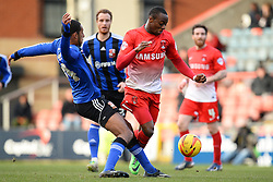 Swindon's Jamie Reckord and Orient's Moses Odubajo compete for the ball - Photo mandatory by-line: Mitchell Gunn/JMP - Tel: Mobile: 07966 386802 22/02/2014 - SPORT - FOOTBALL - Brisbane Road - Leyton - Leyton Orient V Swindon Town - League One