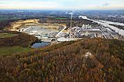 Nederland, Limburg, Maastricht, 07-03-2010; Sint-Pietersberg, gezien in noordelijke  richting van de Maas, mergelgroeve voor de winning van mergel (eigenlijk kalksteen) in dagbouw door cementfabriek ENCI. Berg D'n Observant op de voorgrond. Maastricht aan de horizon. Wat er nog resteert van de St.Pietersberg, rond de greeve, is beschermd natuurgebied en bovengronds en ondergronds aangewezen als beschermd Habitatrichtlijngebied. Marl quarry for the extraction of marl (limestone actually) in surface mining by cement factory ENCI. Maastricht at the horizon. What is left of the Sint-Pietersberg is designated as protected area, both on groundlvel and underground the habitat directives apply. luchtfoto (toeslag), aerial photo (additional fee required); foto/photo Siebe Swart