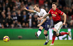 Tottenham Hotspur's Harry Kane (left) attempts a shot on goal