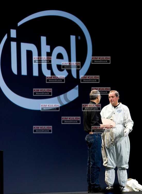 Apple CEO Steve Jobs along with Intel CEO Paul Otellini, appearing in a clean-room suit,  announce that all new macs including the now shipping Imac contain Intel chips.  New Apple laptops will ship later this year. Huge crowds attended the first day of keynotes and exhibits in San Francisco, Calif January 10, 2006. Photo by Kim Kulish