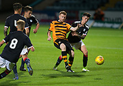 Alloa Athletic's Craig Malcolm and Dundee&rsquo;s Sam Dryden tussle for the ball  - Dundee under 20s v Alloa Athletic in the Irn Bru Cup Round 1 at Dens Park, Dundee - photograph by David Young<br /> <br />  - &copy; David Young - www.davidyoungphoto.co.uk - email: davidyoungphoto@gmail.com