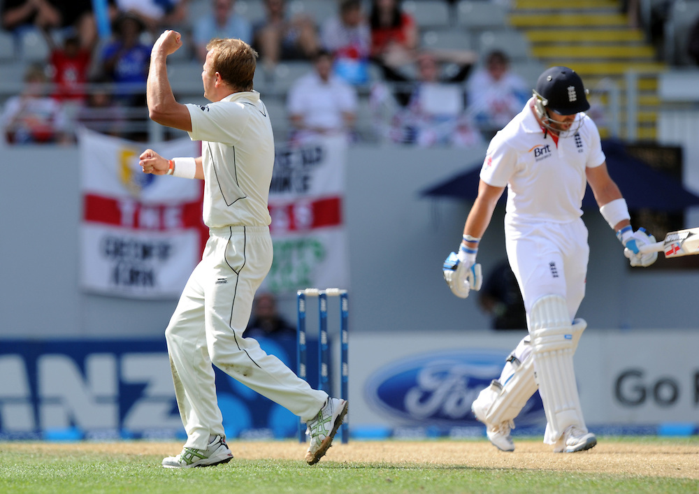 New Zealand's Neil Wagner, left, celebrates the dismissal of England's Matt Prior for 73, caught Hamish Rutherford on the third day of the 3rd international cricket test, Eden Park, Auckland, New Zealand, Sunday, March 24, 2013. Credit:SNPA / Ross Setford