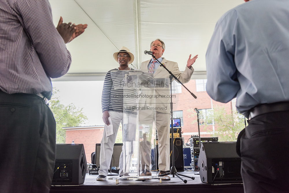 Charleston Mayor John Tecklenburg, right, joins Anthony Thompson, husband of shooting victim Myra Thompson during a memorial service for those killed in the Mother Emanuel African Methodist Episcopal Church shooting on the 2nd anniversary June 17, 2017 in Charleston, South Carolina. Nine members of the historic African-American church were gunned down by a white supremacist during bible study on June 17, 2015.