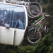 Mountain Bike racers take the Skyline Gondola to tackle the Ben Lomond Forest course high above Queenstown during the Outside Sports Super D Enduro event in Queenstown, Central Otago, at the Weekend. The 6 hour non stop team and individual races attracted 86 competitors and included Skyline Gondola access. The event was part of the inaugural Queenstown Bike Festival, taking place from 16th-25th April. The event hopes to highlight Queenstown's growing profile as one of the three leading biking centres in the world. Queenstown, Central Otago, New Zealand. 16th April 2011. Photo Tim Clayton..