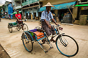 14 JUNE 2013 -  PATHEIN, AYEYARWADY, MYANMAR: Pedicabs in Pathein, Myanmar. Pathein, sometimes also called Bassein, is a port city and the capital of the Ayeyarwady Region, Burma. It lies on the Pathein River (Bassein), which is a western branch of the Irrawaddy River. It's the fourth largest city in Myanmar (Burma) about 190 km west of Yangon.  PHOTO BY JACK KURTZ