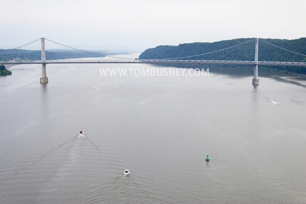 Highland, New York - A view of boats in the Hudson River with the Mid-Hudson Bridge in the background from the Walkway over the Hudson on May 27, 2012.