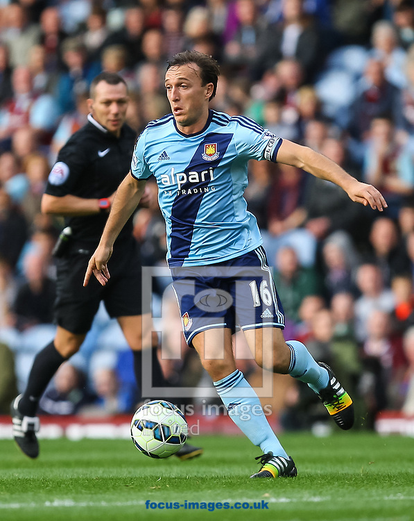 Mark Noble of West Ham United on the ball during the Barclays Premier League match at Turf Moor, Burnley<br /> Picture by Daniel Chesterton/Focus Images Ltd +44 7966 018899<br /> 18/10/2014