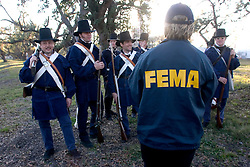 07 Jan, 2006. New Orleans, Louisiana.  Post Katrina. <br /> A representative from FEMA talks to soldiers at the Battle of New Orleans re-enactment at Packenham Oaks in Chalmette near New Orleans, Louisiana to ensure any that need assistance are claiming it. Period costumed British and American men along with 'irregulars' from the Independence/Civil War period commemorated the battle of Jan 8th, 1815 - the last battle of the war of 1812. The British led by General Edward Packenham were soundly defeated by troops hastily assembled by General Andrew Jackson. <br /> Photo; Charlie Varley/varleypix.com