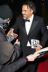 © Licensed to London News Pictures. 14/02/2016. London, UK. ALEJANDRO GONZALEZ INARRITU arrives on the red carpet for the EE British Academy Film Awards 2016 after party held at Grosvenor House . London, UK. Photo credit: Ray Tang/LNPPhoto credit: Ray Tang/LNP