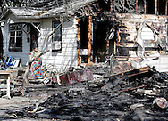 Andy Mitchell looks over her house and her neighbors as HFD investigators work the scene of a fire at 3809 Reid St. on Tuesday, March 22, 2016 in Houston, TX. The owner of the house was transported to a hospital his neighbors house at 3805 Reid Rd. also caught on fire but the occupants escaped safely. (Photo: Thomas B. Shea/For the Chronicle)