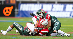 15.07.2011, Ernst Happel Stadion, Wien, AUT, American Football WM 2011, Japan (JAP) vs Mexico (MEX), im Bild Tomokazu Sueyoshi  (Japan, #31, RB) gets stopped by Valdez Jorge enrique (Mexico, #5, LB) and Vazquez Alejandro (Mexico, #9, LB)  // during the American Football World Championship 2011 game, Japan vs Mexico, at Ernst Happel Stadion, Wien, 2011-07-15, EXPA Pictures © 2011, PhotoCredit: EXPA/ T. Haumer