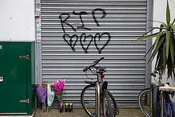 © Licensed to London News Pictures. 19/06/2018. London, UK. 'RIP' is graffitied by Loughborough Junction station as tributes and flowers are left for the three graffiti artists believed to have been killed by a night train. Photo credit: Rob Pinney/LNP