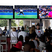 August 29, 2017 - New York, NY : Fans down drinks at a bar as they watch the Spanish tennis player Rafael Nadal, in pink, compete against the Serbian player Dušan Lajović, on television screens, on the second day of the U.S. Open, at the USTA Billie Jean King National Tennis Center in Queens, New York, on Tuesday afternoon. <br /> CREDIT : Karsten Moran for The New York Times