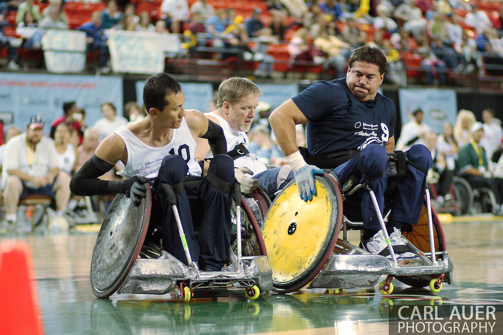 July 7th, 2006: Anchorage, AK - William Groulx (10) tries to maneuver around Blue team hard hitter Scot Severn as White defeated Blue in the gold medal game of Quad Rugby at the 26th National Veterans Wheelchair Games.