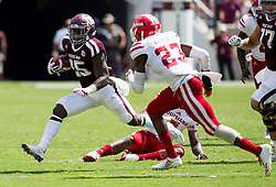 Texas A&M running back Kendall Bussey (25) turns the corner against Louisiana-Lafayette defensive back Tracy Walker (23) during the fourth quarter of an NCAA college football game Saturday, Sept. 16, 2017, in College Station, Texas. (AP Photo/Sam Craft)