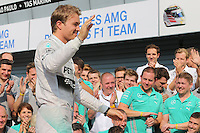 Nico Rosberg (GER) Mercedes AMG F1 celebrates a 1-2 finish with the team.<br /> Italian Grand Prix, Sunday 7th September 2014. Monza Italy.