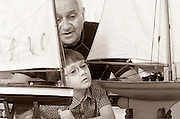 grandfather and grandson looking at ship models