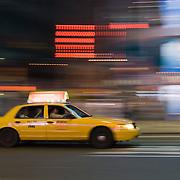 Taxi Speeding through Times Square