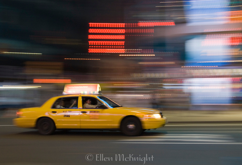 Taxi Speeding through Times Square