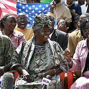 Mama Sarah, president-elect Barack Obama's step-grandmother and Barack Obama's half siblings Said (left) and Auma Obama, are all smiles at a press conference at the family homestead, following Obama's victory. November 5, 2008. Photo by Evelyn Hockstein for The New York Times.