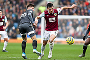 Burnley midfielder Jack Cork challenged by the opponent during the Premier League match between Burnley and Leicester City at Turf Moor, Burnley, England on 19 January 2020.