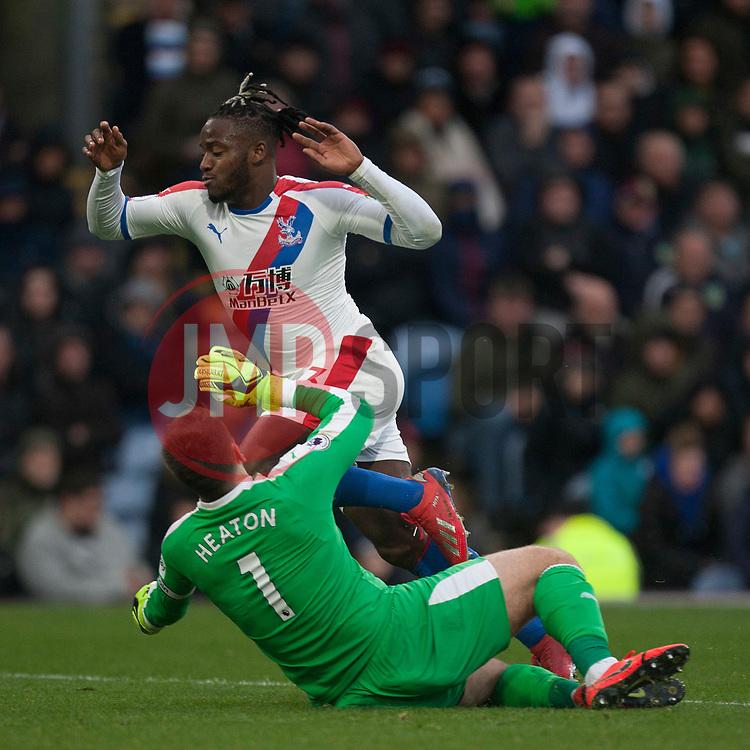 Michy Batshuayi of Crystal Palace (Top) takes the ball around Thomas Heaton of Burnley - Mandatory by-line: Jack Phillips/JMP - 02/03/2019 - FOOTBALL - Turf Moor - Burnley, England - Burnley v Crystal Palace - English Premier League