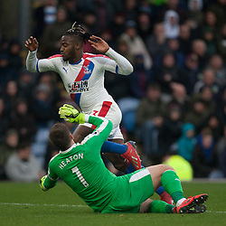 Michy Batshuayi of Crystal Palace (Top) takes the ball around Thomas Heaton of Burnley - Mandatory by-line: Jack Phillips/JMP - 02/03/2019 - FOOTBALL - Turf Moor - Burnley, England - Burnley v Crystal Palace - English Premier League