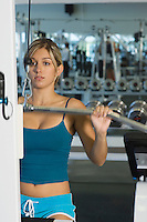 Young Woman Working Out on Weightlifting Machine