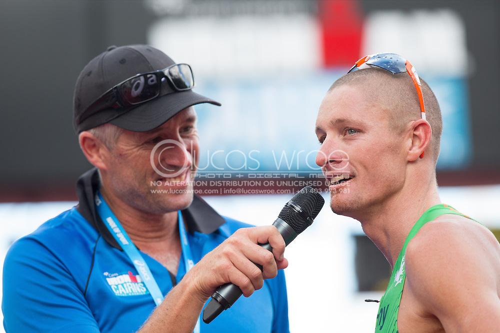 An emotional Luke Mckenzie (AUS) Is interviewed by Pete Murray. Ironman Cairns and Ironman Cairns 70.3 Race. 2013 Ironman Cairns Triathlon Festival. Cairns, Queensland, Australia. 09/06/2013. Photo By Lucas Wroe