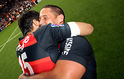 Clement Poitrenaud celebrates with Luke McAlister of Stade Toulousain after the match. Toulouse v Castres, Top 14, Demi-Finale, Stade Municipal, Toulouse, France, June 2nd 2012