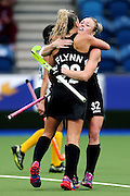 Anita Punt and Gemma Flynn of New Zealand celebrate a goal during the bronze medal match between New Zealand and South Africa. Glasgow 2014 Commonwealth Games. Hockey, Bronze Medal Match, Black Sticks Women v South Africa, Glasgow Green Hockey Centre, Glasgow, Scotland. Saturday 2 August 2014. Photo: Anthony Au-Yeung / photosport.co.nz
