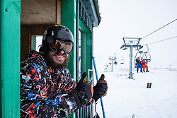 Glenshee, Scotland, United Kingdom. 3 February, 2018. New snow falls at Glenshee Ski Centre in the Cairngorms brought many skiers eager to enjoy the good calm conditions. Weather is expected to be good for the rest of the weekend and large crowds are expected to take advantage of excellent conditions. Pictured David Campbell keeps an eye on chair lift operations,