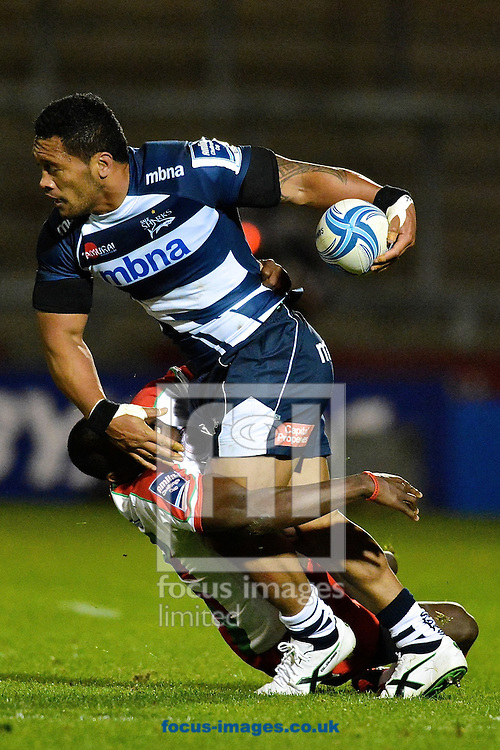 Picture by Ian Wadkins/Focus Images Ltd +44 7877 568959<br /> 10/10/2013<br /> Johnny Leota of Sale Sharks is tackled by Taku Ngwenya of Biarritz Olympique during the Amlin Challenge Cup match at AJ Bell Stadium, Eccles.