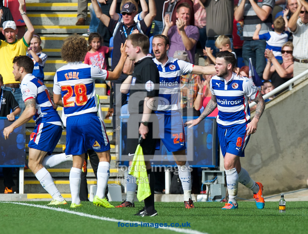 Danny Guthrie of Reading (8) celebrates with  Aaron Kuhl (28) and goal scorer Glenn Murray (20)who gets a late equaliser to finish the game at 3-3 during the Sky Bet Championship match at the Madejski Stadium, Reading<br /> Picture by Alan Stanford/Focus Images Ltd +44 7915 056117<br /> 28/09/2014