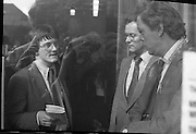 Fergus Rowan sits in at Bank of Ireland.  (J70)..1975..22.08.1975..08.22.1975..22nd August 1975..As a result of the 1970 bank strike which lasted for six months, the Rowan family business found itself in financial difficulties. During the strike the Rowans had had to accept cheques in good faith in order to stay in business. When the cheques came for settlement the bank refused as they stated that some were 'dodgy'. This put severe strain on the business which was eventually put into receivership.As part of the process the Rowan business beside the bank was put up for sale and was purchased by B.o I. Rowan was outraged and started a campaign against the bank which culminated in a sit in at the banks headquarters in Westmoreland St,Dublin. He also became a thorn in the side of the bank at the A.G.Ms raising many points...Picture shows a High Court Order being served on Fergus Rowan by court official Mr Paul Harman. The order was served to force Mr Rowan to vacate the premises.