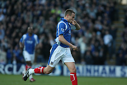 PORTSMOUTH, ENGLAND - SATURDAY, DECEMBER 9th, 2006: Matthew Taylor of Portsmouth celebrates scoring the first Portsmouth goal against Everton during the Premiership match at Fratton Park. (Pic by Chris Ratcliffe/Propaganda)