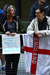 © Licensed to London News Pictures . 27/09/2018. London, UK. Supporters of  former EDL leader Tommy Robinson (real name Stephen Yaxley-Lennon ) demonstrate outside the Old Bailey , as Robinson faces a retrial for Contempt of Court following his actions outside Leeds Crown Court in May 2018 . Robinson was already serving a suspended sentence for the same offence when convicted in May and served time in jail as a consequence , but the newer conviction was quashed by the Court of Appeal and a retrial ordered . Photo credit: Peter Macdiarmid/LNP
