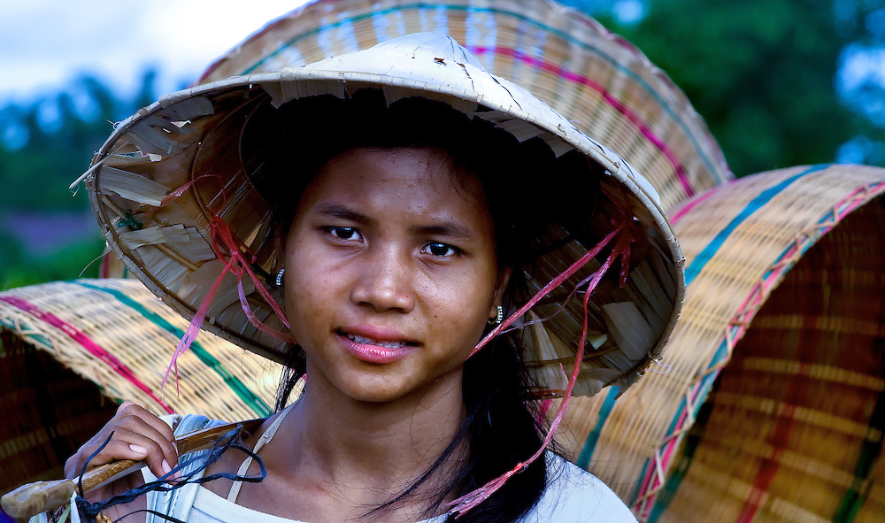 A girl taking her baskets to the market on the Bolaven Plateau