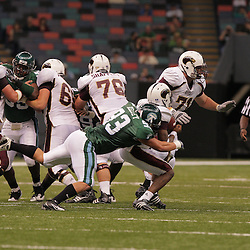 20 September 2008: Tulane defensive end Logan Kelley (93) sacks Louisiana-Monroe quarterback Kinsmon Lancaster (7) during a Conference USA match up between the University of Louisiana Monroe and Tulane at the Louisiana Superdome in New Orleans, LA.