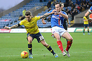 Oxford United defender George Baldock and Oxford United midfielder Kemar Roofe battle during the Sky Bet League 2 match between Oxford United and Carlisle United at the Kassam Stadium, Oxford, England on 12 December 2015. Photo by Alan Franklin.